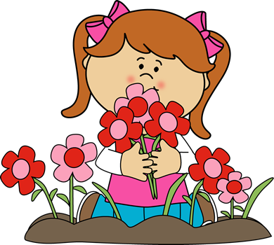 A girl planting flowers in the garden