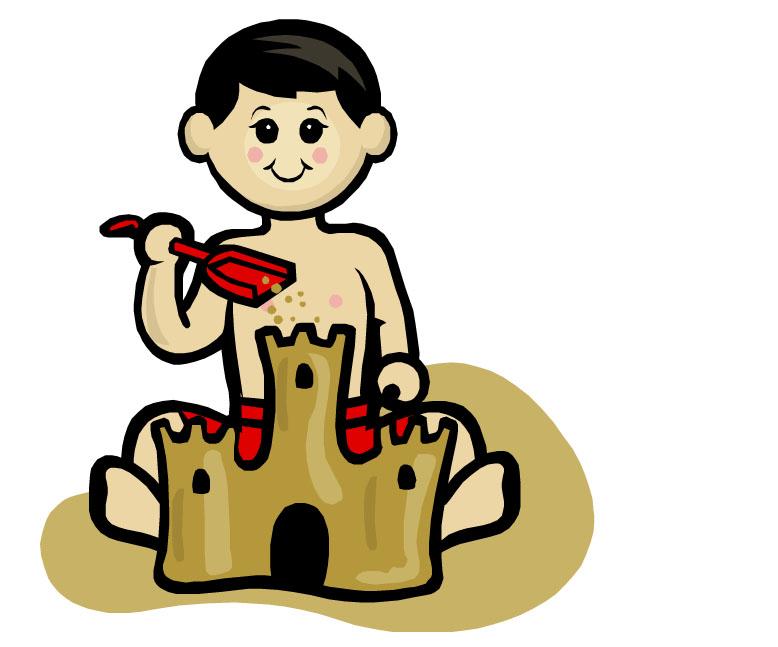 A boy building a sandcastle