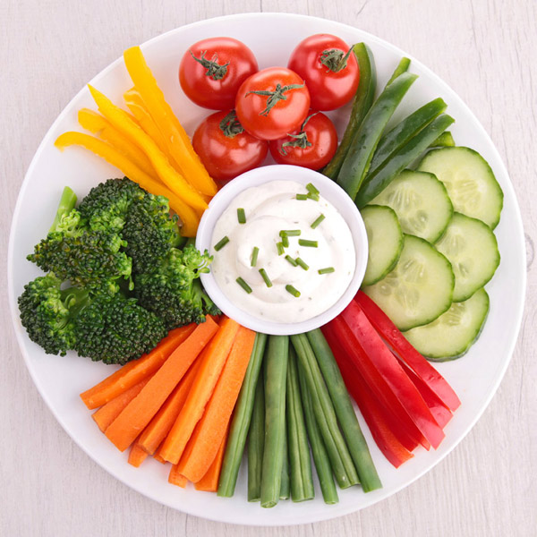 A plate of vegetables and dip.