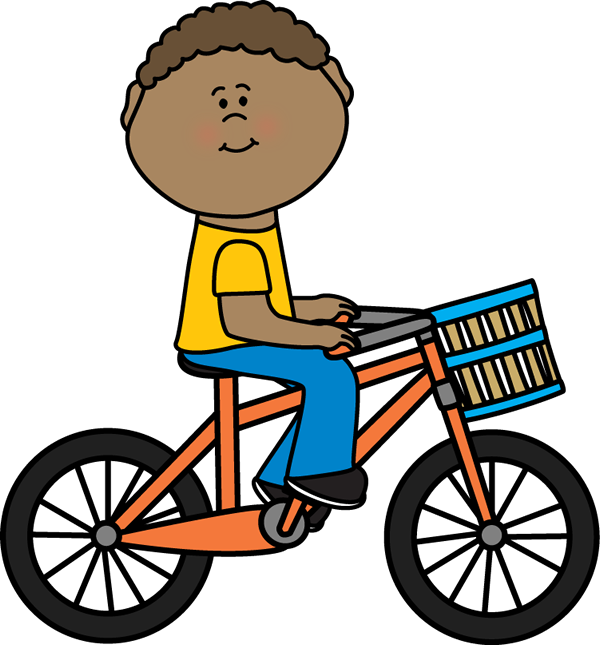 A boy riding a bike.