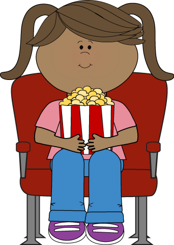 A girl sitting at movie theater with popcorn.