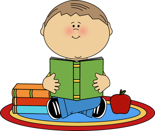 `A boy is sitting on a rug reading books.