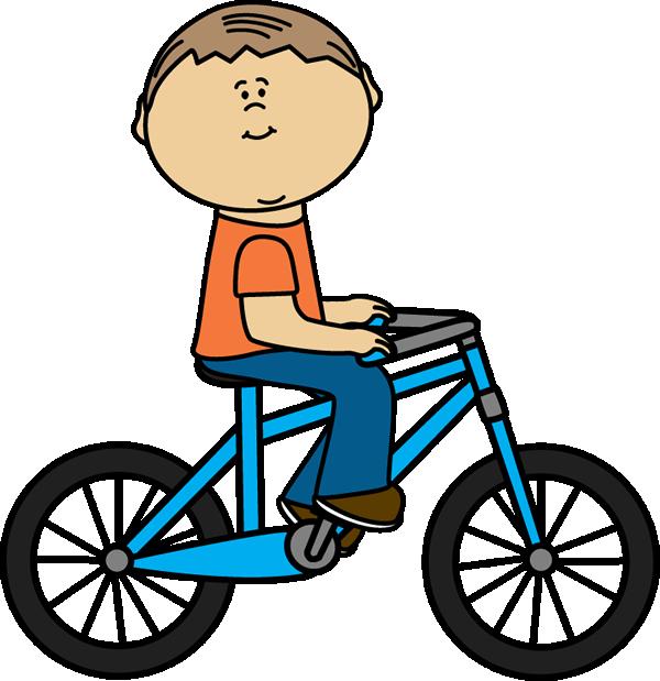A boy is riding his bike.