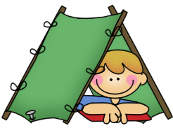 A boy laying in a tent while camping.