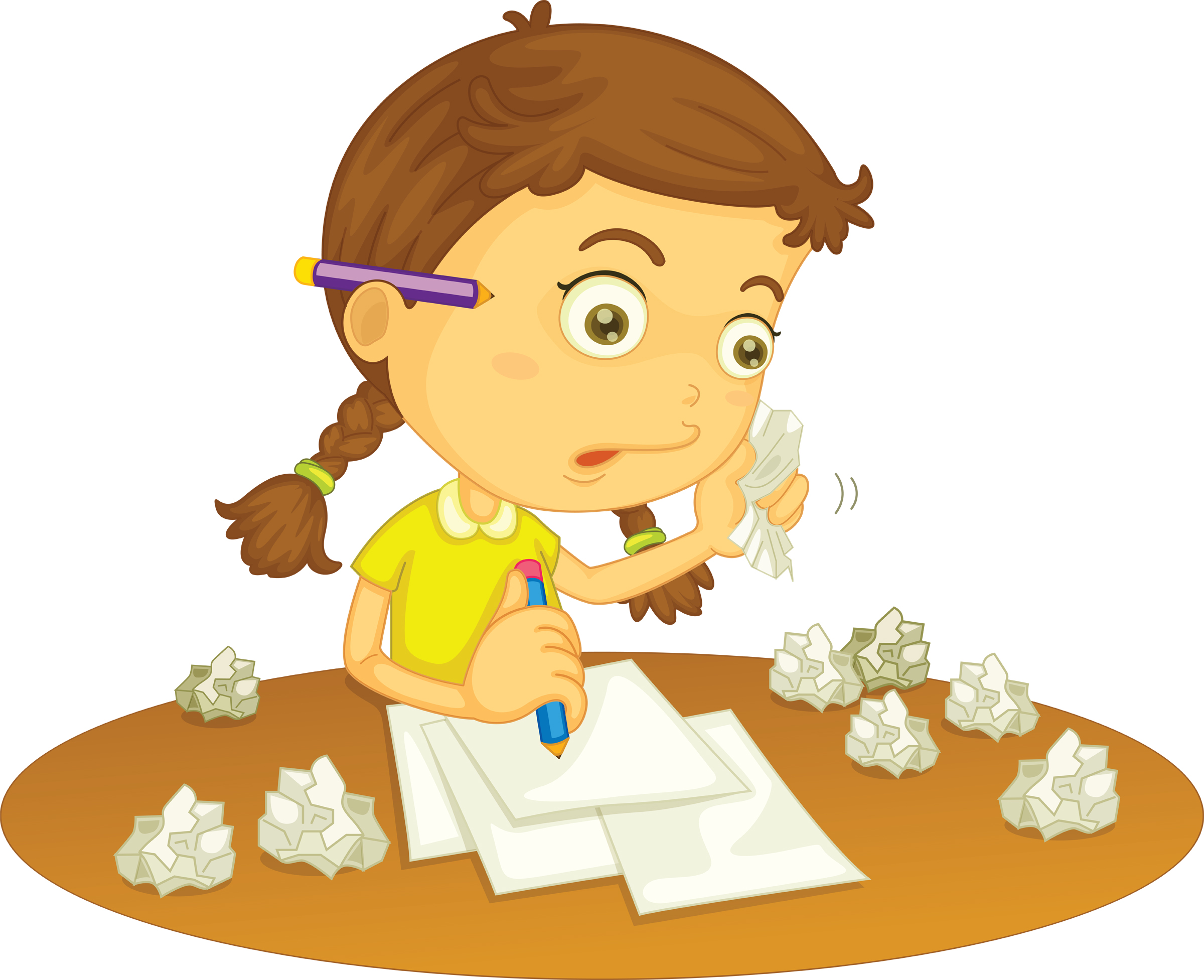 A girl doing her homework with crumbled pieces of paper on her desk.