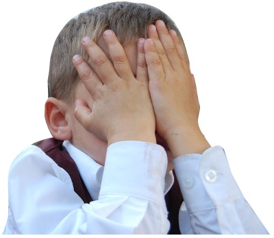 boy covering his eyes with his hands