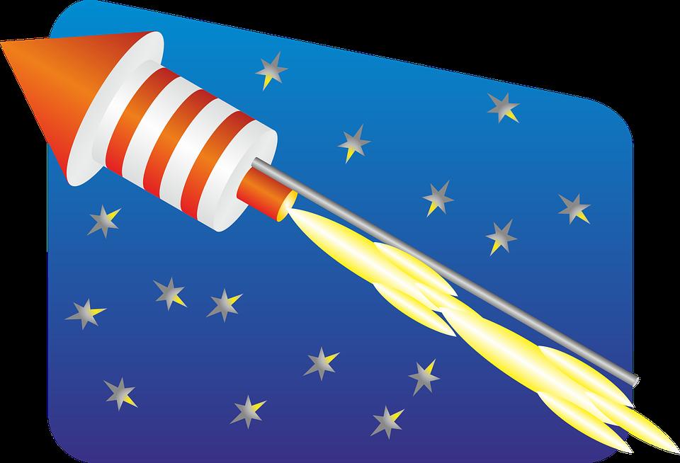 A rocket shooting across the night sky.
