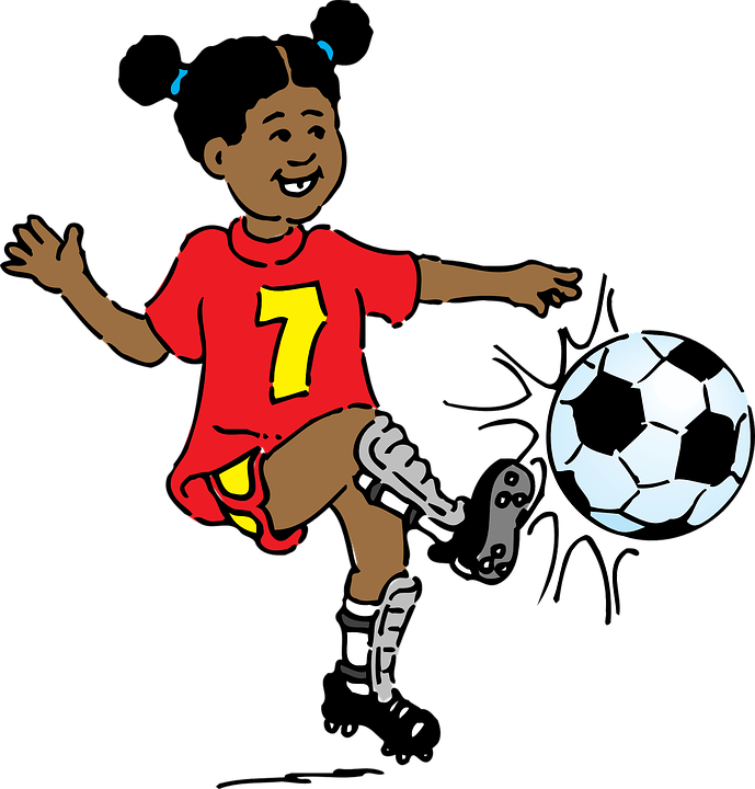 A girl kicking a soccer ball.