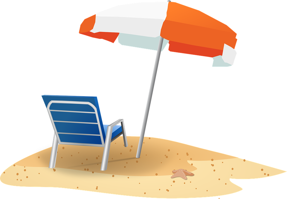 A chair and umbrella in the sand at the beach.