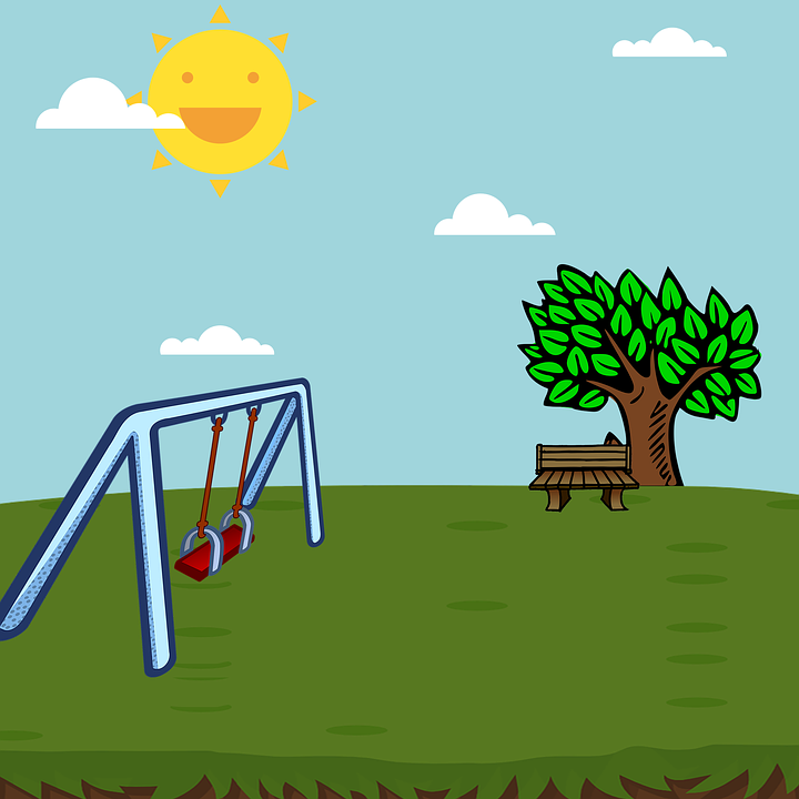 A swing set at the park on a sunny day.