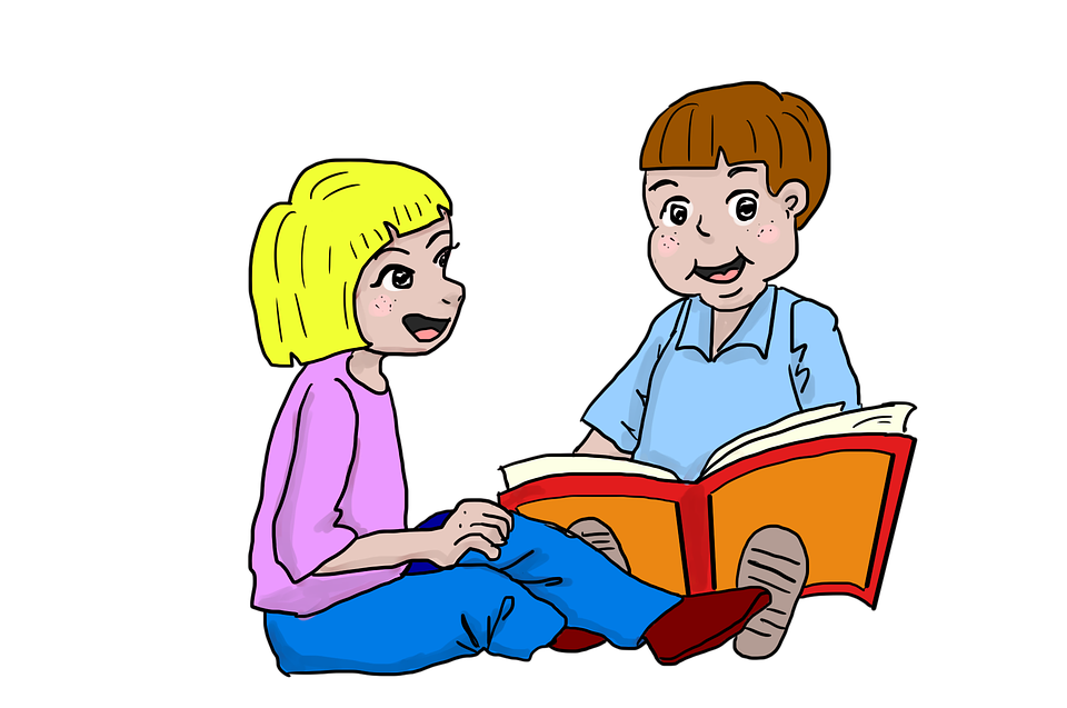 Two kids reading a book together.