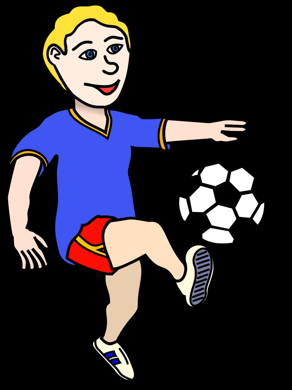 A boy is kicking a soccer ball.