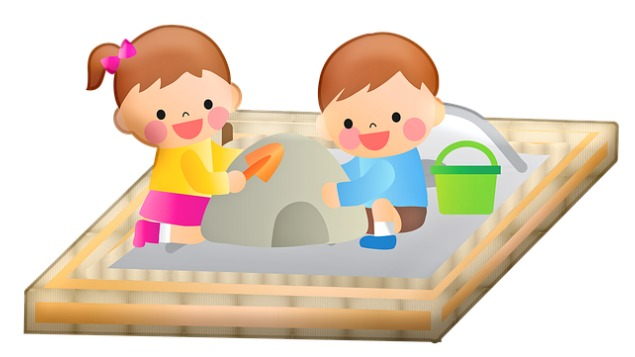 Children playing in a sandbox.