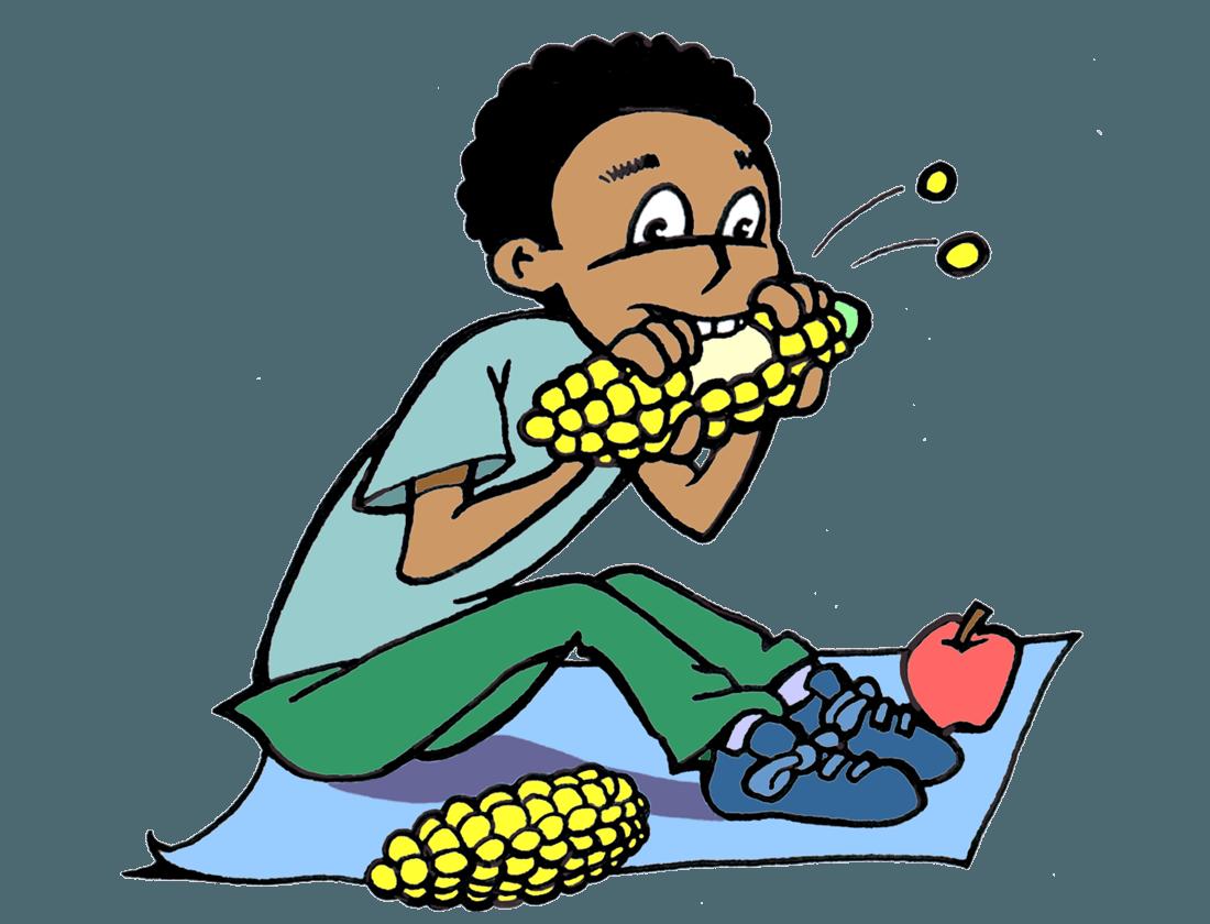 A boy eating corn on the cob.