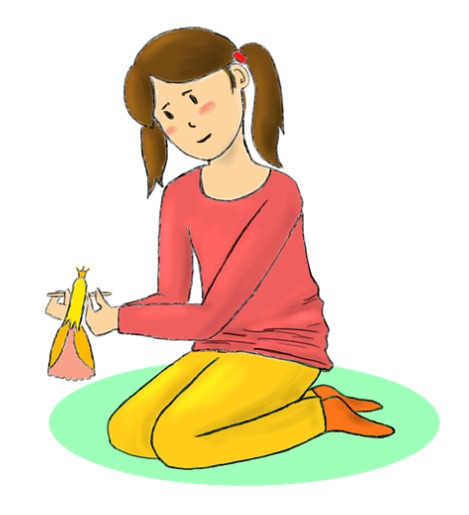 A girl is playing with her doll.