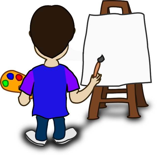A boy is painting.