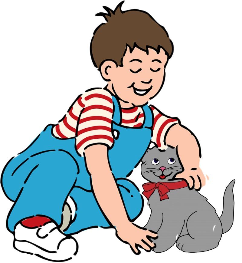 A boy is petting a cat.