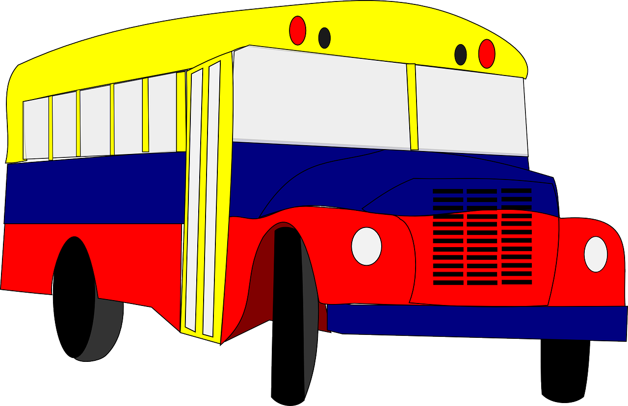 A bus painted yellow, blue, and red.